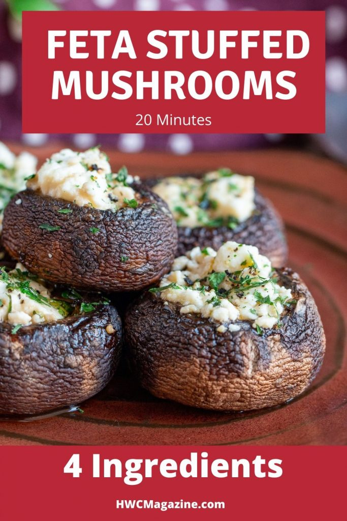 5 delicious feta stuffed portabella mushrooms on a handmade copper colored plate garnished with fresh parsley.