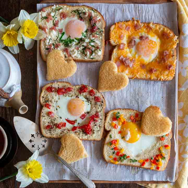 4 delicious egg in the hole breakfast options on a platter.