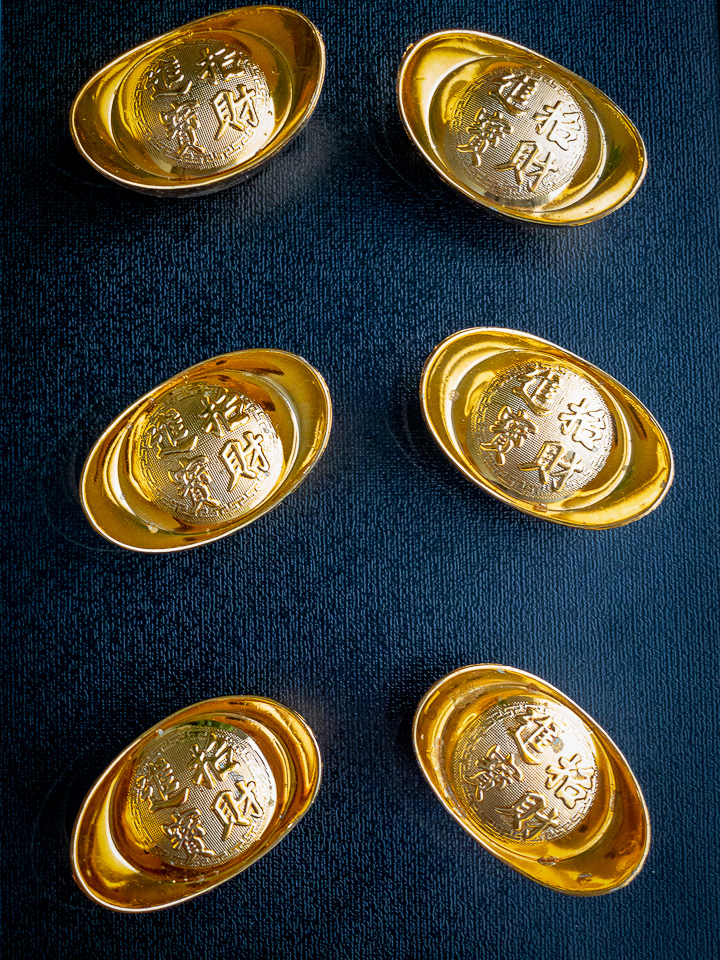 small gold ingots on a black background.