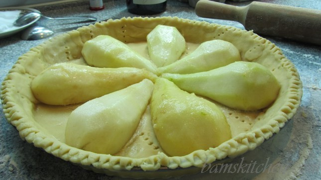 Halved peeled Pears placed inside the tart shell.
