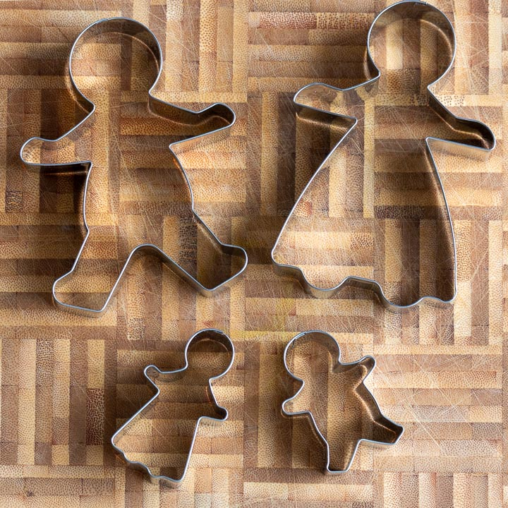 4 gingerbread men and women cookie cutters.