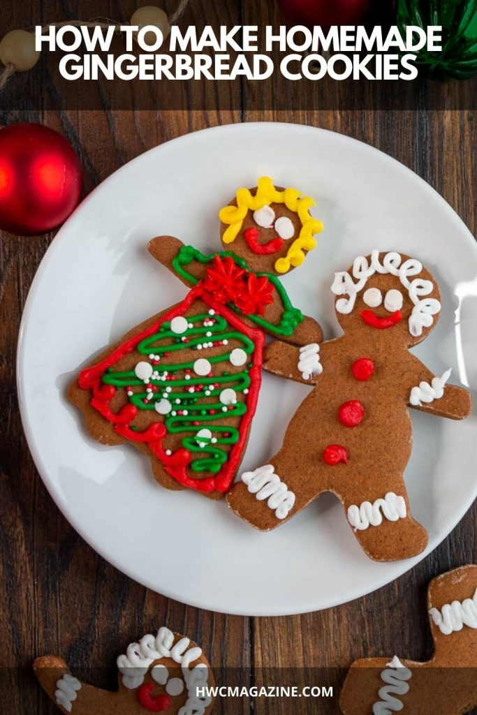 2 decorated cutout gingerbread cookies on a white plate.