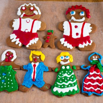 Cute decorated gingerbread and boys all lines up holding hands