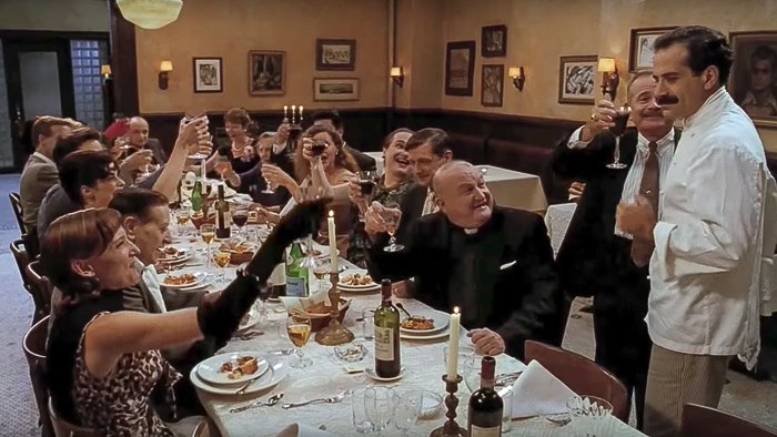 Last scene of the movie big night at the big long table and toast of wine