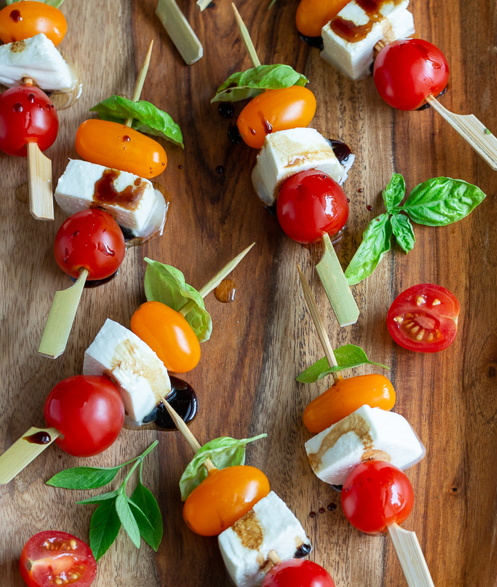 Super cute caprese salad on a stick drizzled with balsamic and EVOO.