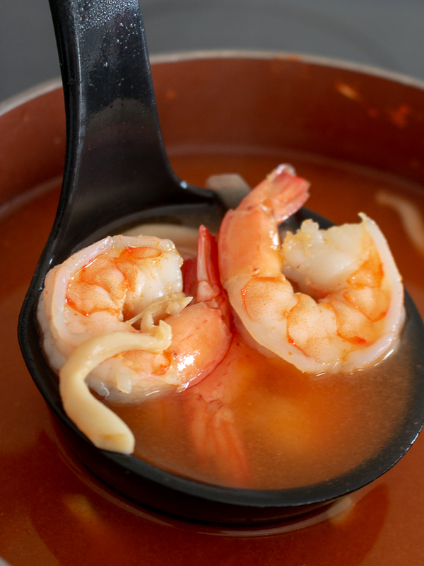 Soup ladle of shrimp and soup broth.