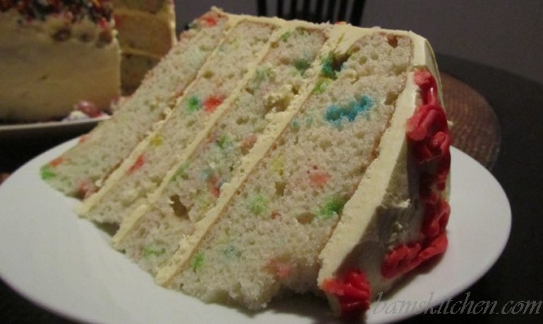 Four Tiered confetti cake with buttercream frosting
