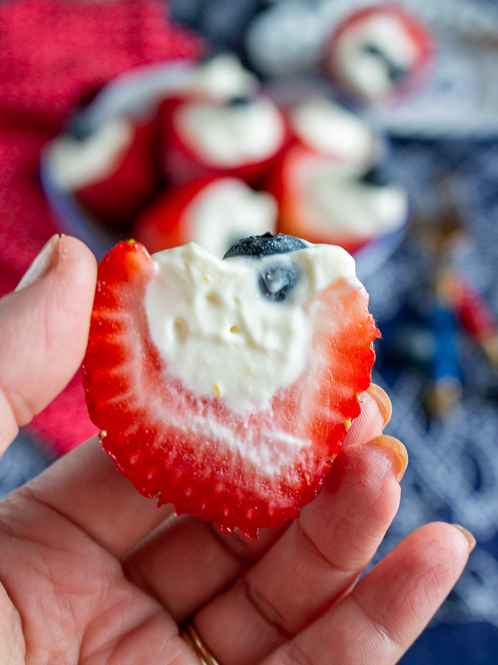 A stuffed strawberry cut in half to show the filling.
