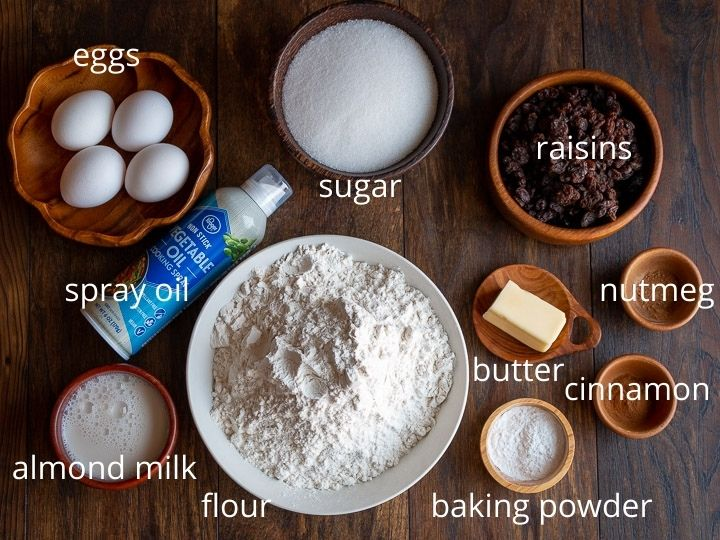 Ingredients to make the cakes set out on a wooden board.