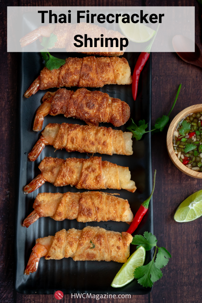 Thai Firecracker Shrimp Party Appetizer is a deliciously marinated shrimp with the tail on, bundled in a spring roll wrapper and pan fried until golden. Served with a Prik Nam Pla dipping sauce. #thai #qppetizer #shrimp #springrolls #firecracker #asian #easyrecipe #eattheworld / https://www.hwcmagazine.com