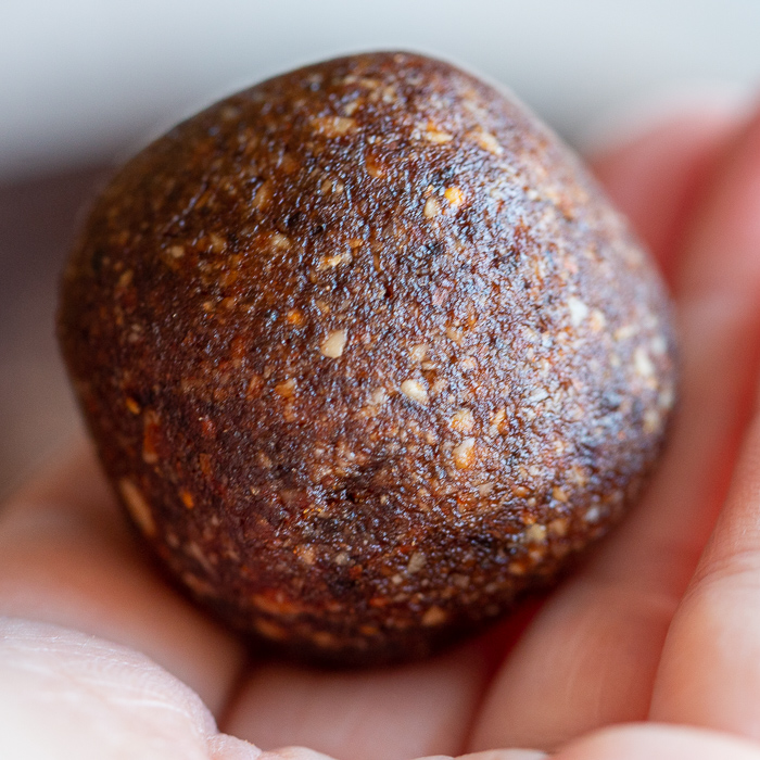 Chocolate Espresso Fig balls just rolled into a nice little ball. Held in hand.