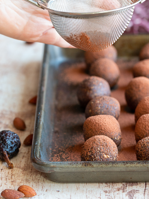 Cocoa powder getting dusted over the Chocolate Espresso Fig Balls.