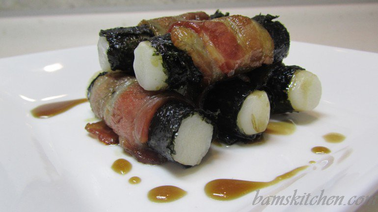 Baked Dduk lavered with bacon