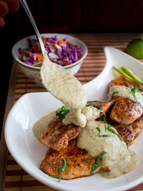 Tomatillo roasted salsa drizzling over the grilled chicken breasts