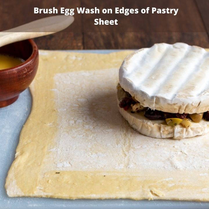Brush sides of pastry dough with egg wash.