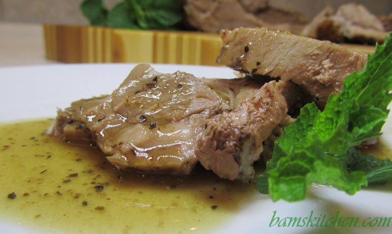 Slow roasted rosemary lamb with caramelized onion gravy