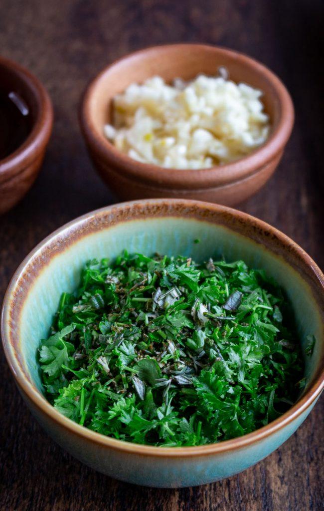 Bowl of fresh chopped herbs and garlic.