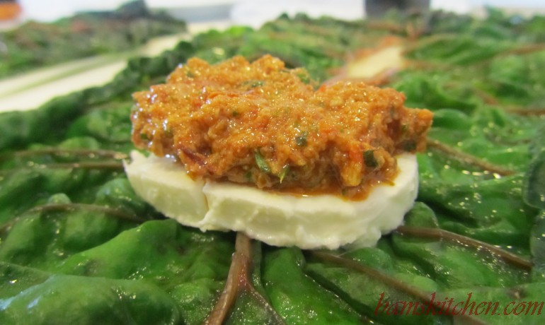 Steamed swiss chard leaf topped with mozzarella and a dollop of red pepper pesto.