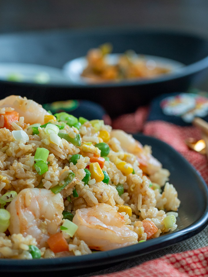 Huge bowl to share of fried rice displayed with Chinese New Year cloths.