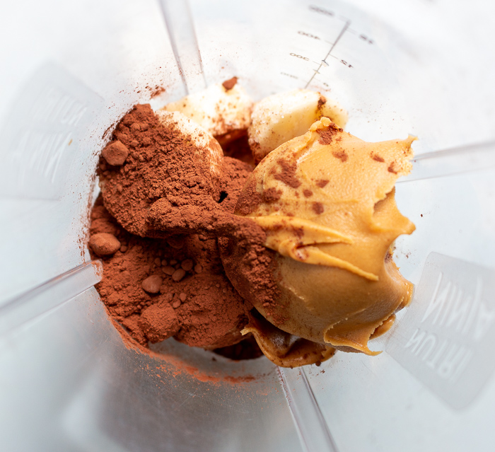 Chopped frozen bananas, unsweetened cocoa powder, and nut butter of choice in your blender.