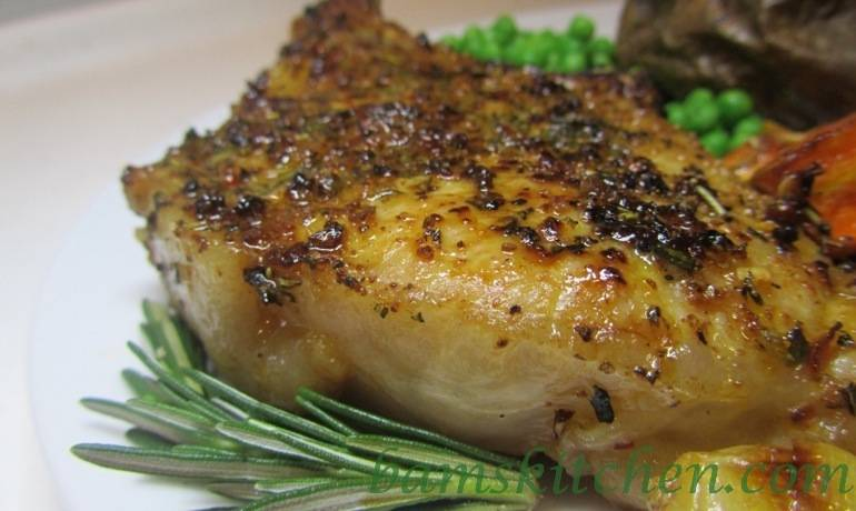 Rosemary herbed pork chops with shallot wine sauce..