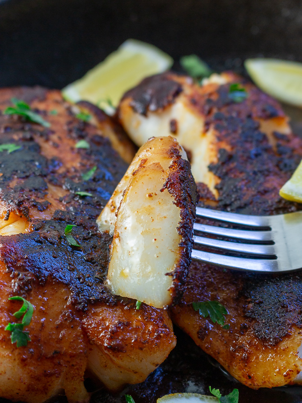 Delicious flaky bite of Cajun Blackened Cod.