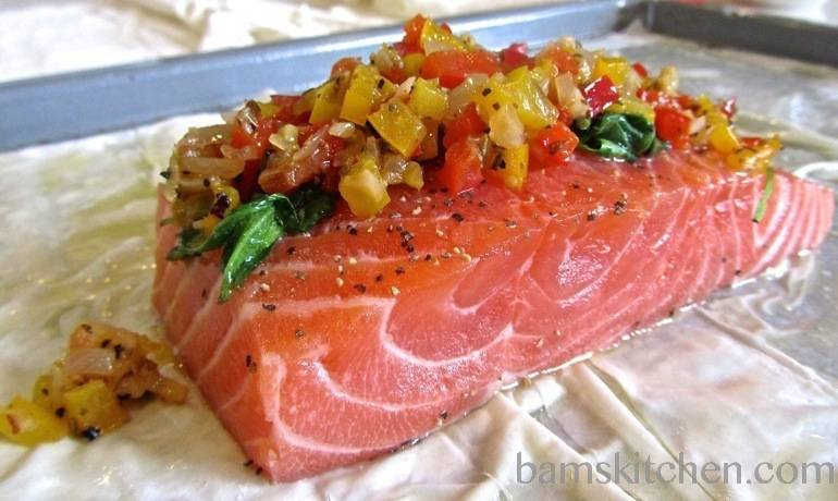 Salmon getting piled high with vegetables and ready to get wrapped with the phyllo dough.