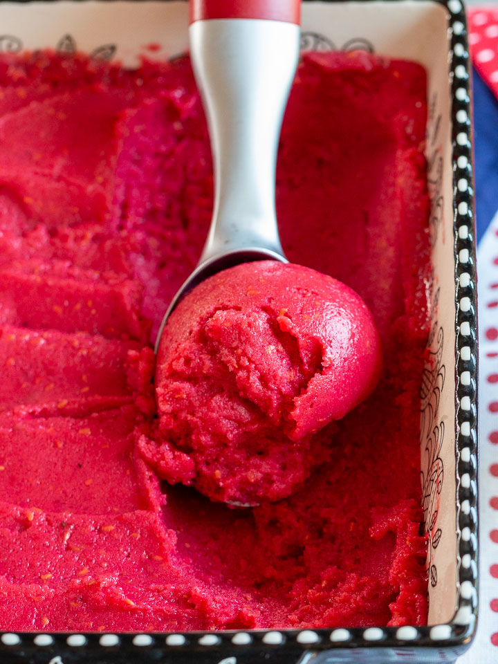 Raspberry sorbet scooped and ready to be served.