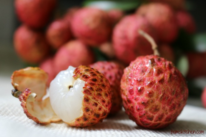 Fresh lychees on a white towel.