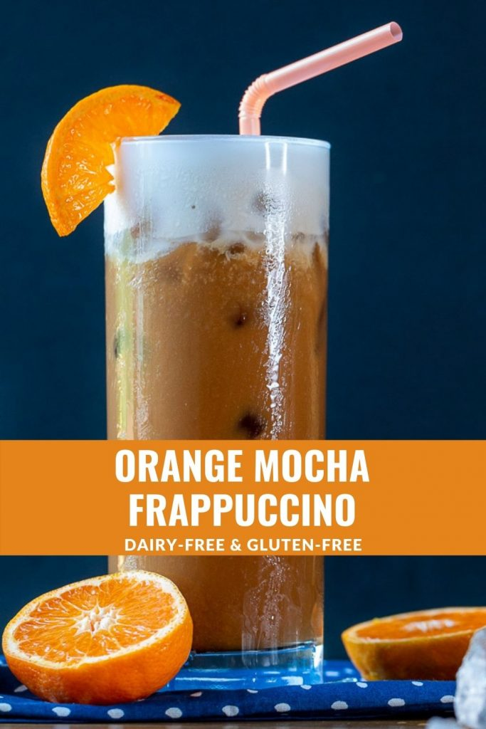Frothy mixed orange and espresso Frappuccino garnished with fresh oranges.