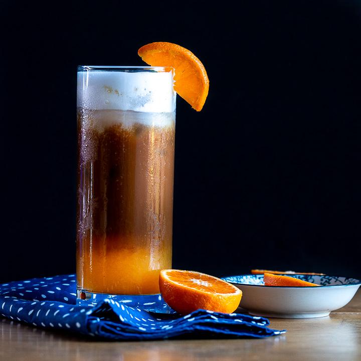 Dark and moody 3 layered Good Morning Vietnam cocktail.
