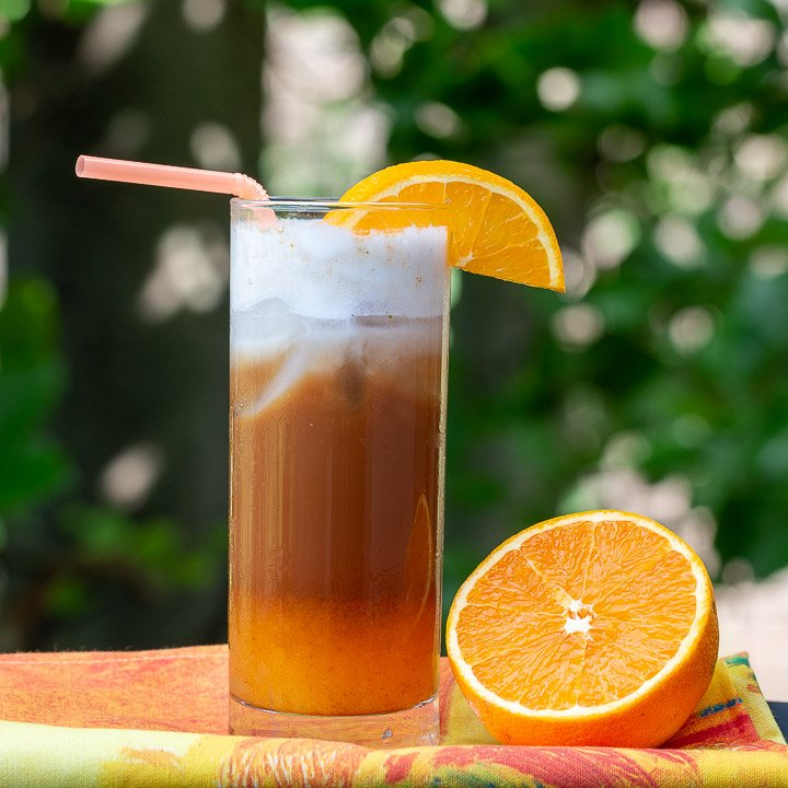 Outdoors sunny shot of three layers of iced bumblebee coffee.
