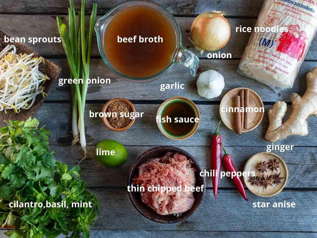 Beef pho ingredients laid out on the table and labeled.