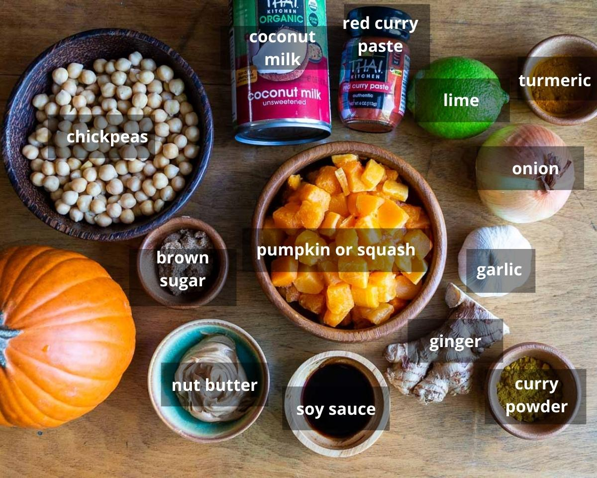 Thai Pumpkin Curry Ingredients laid out on a wooden table.