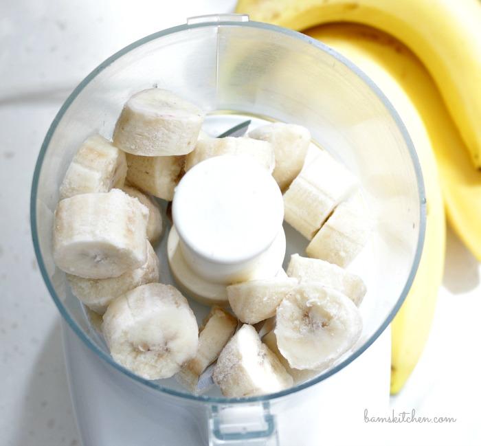 Frozen chopped bananas in the food processor.