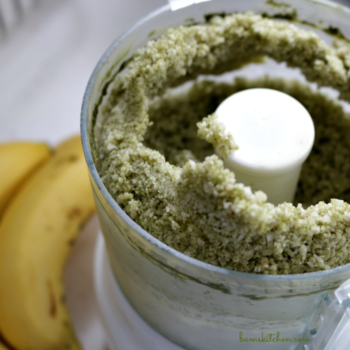Matcha and bananas that have started in the food processor looking like grains of sand.