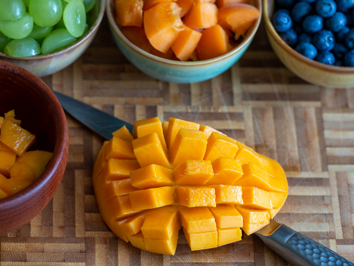 Fresh fruits cut and a mango.