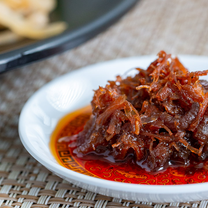 Big dollop of spicy XO sauce on a little Chinese plate.