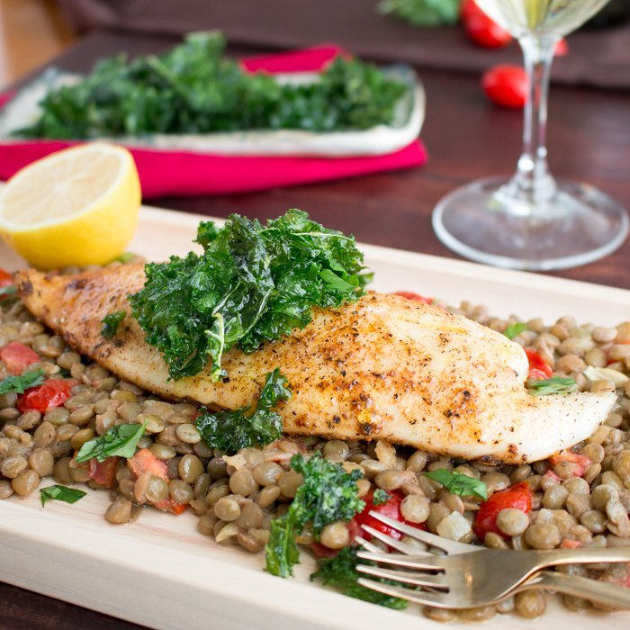 Baked Tilapia with Caramelized Onion Lentils / https://www.hwcmagazine.com