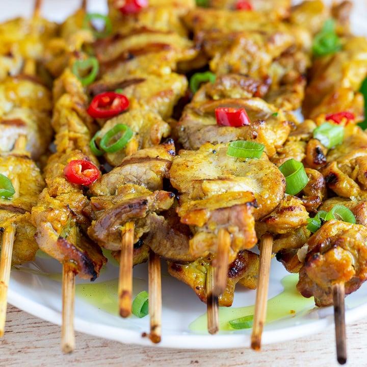 Grilled Thai Pork Tenderloins on a white plate.