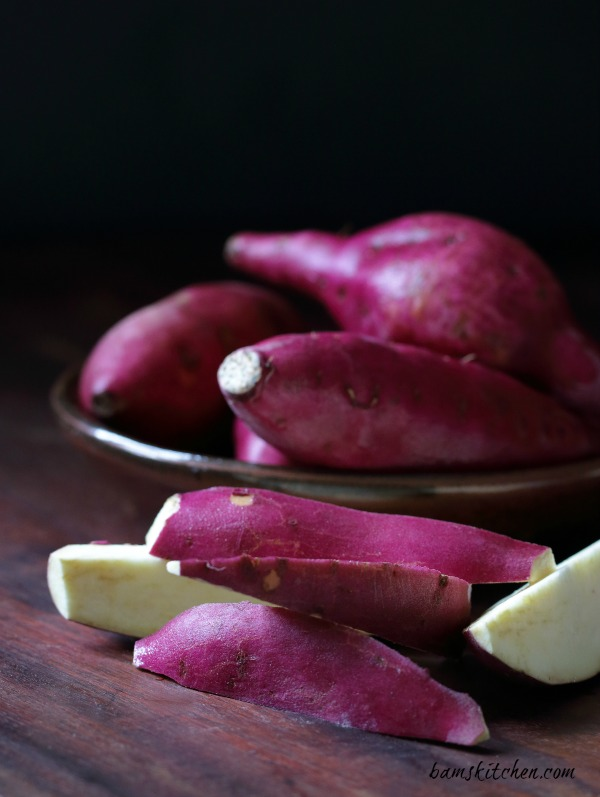 Japanese bright purple sweet potatoes in a brown Japanese pottery bowl.