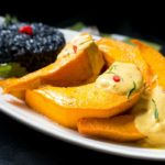 Roasted kabocha squash with curried sauce and black forbidden rice.