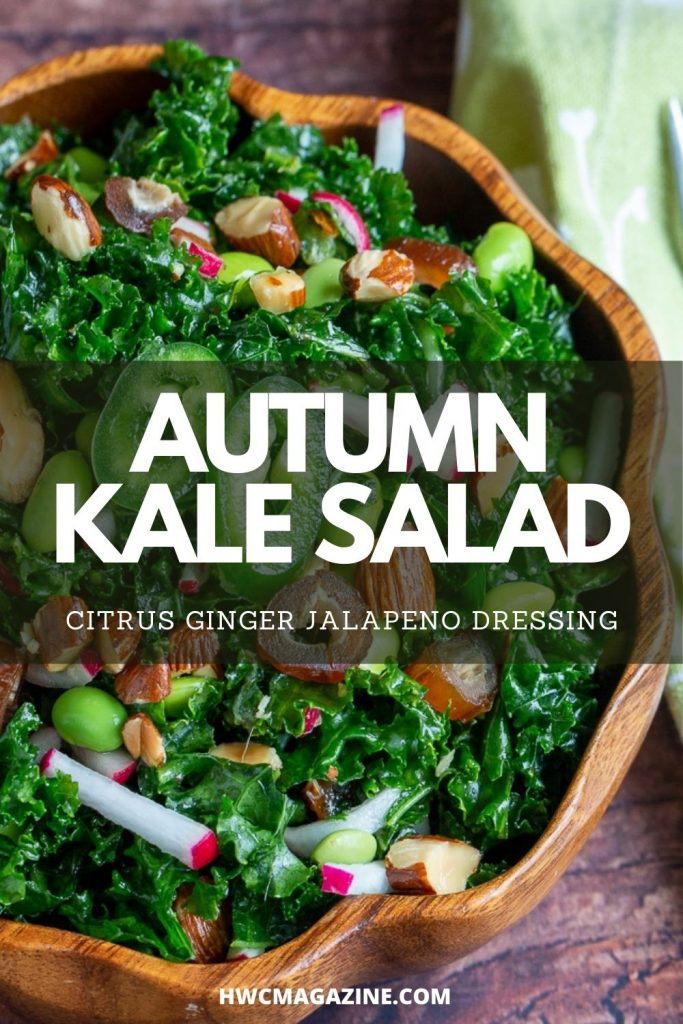 Fall Salad with kale, dates, almonds and veggies in a wooden bowl.