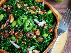 Big bowl of kale salad in a wooden bowl.