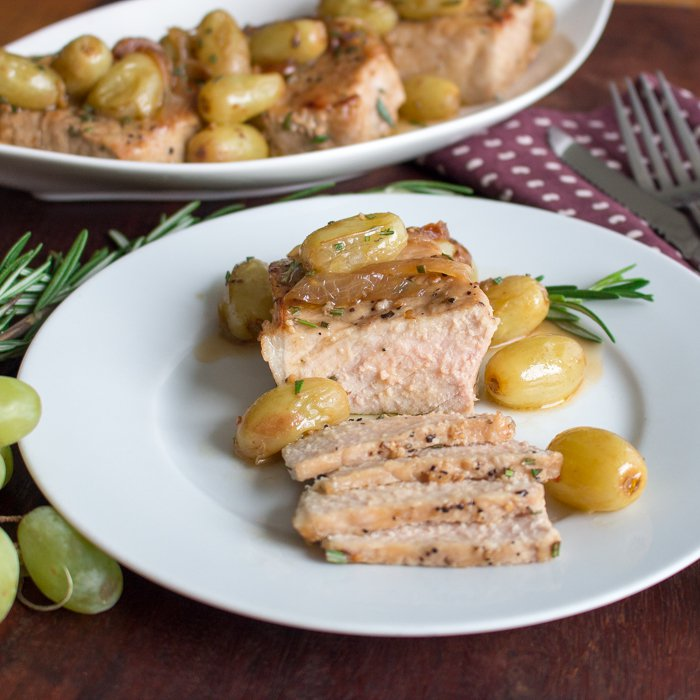 One Pan Rosemary Boneless Pork Chops with Roasted Grapes