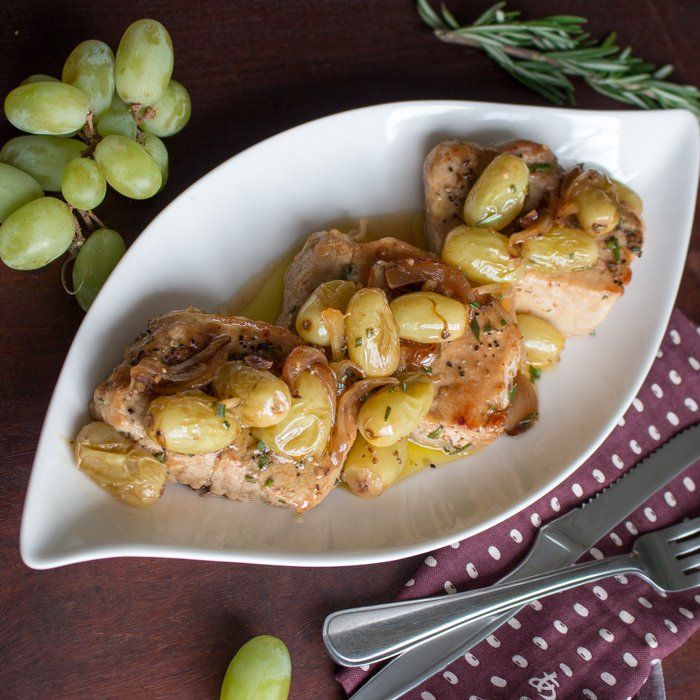 One Pan Rosemary Boneless Pork Chops with Roasted Grapes /https://www.hwcmagazine.com