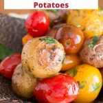 Baby potatoes and tomatoes in a wooden bowl.