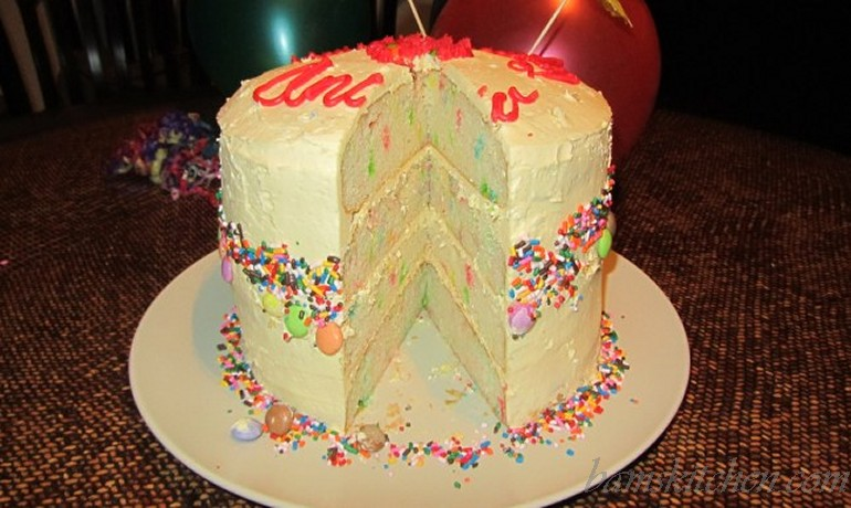 Four Tiered Towering Confetti Birthday Cake With Creamy Buttercream
