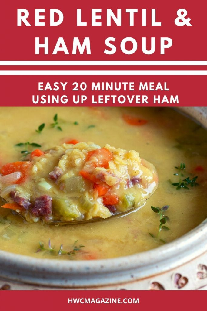 Spoonful of delicious red lentil and ham soup in a beige soup bowl.