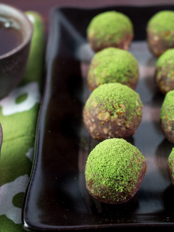 Matcha balls with tea and green tea towel.